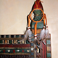 Dreamcatcher hangs on bedpost at the Inn of Five Graces in Santa Fe, New Mexico.