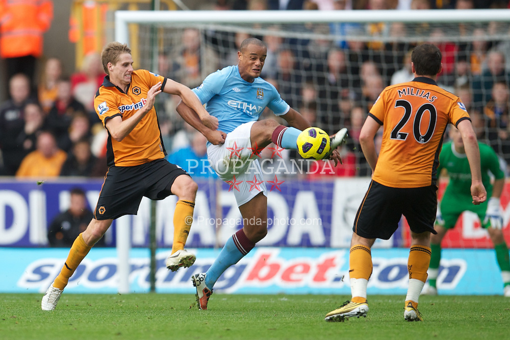 WOLVERHAMPTON, ENGLAND - Saturday, October 30, 2010: Manchester City's Nedum Onuoha and Wolverhampton Wanderers' David Edwards during the Premiership match at Molineux. (Pic by: David Rawcliffe/Propaganda)