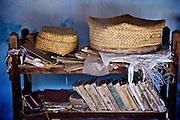 Sabapathy House. Vaddukodai, Jaffna.<br /> Bookshelf and finely woven Jaffna baskets. <br /> Edgar Alan Poe and James Barrie on the shelves. <br /> Jaffna homes. 2011