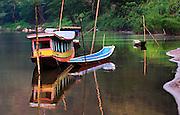 A boat at sunrise on the Nam Ou (river), Laos.