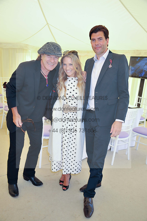 Left to right, singer BRIAN JOHNSON, GEORGIE THOMPSON and RICHARD BLAKE at a luncheon.