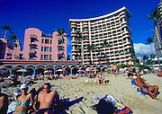 Image of Waikiki Beach on a sunny day with people on the beach and nearby resorts, Honolulu, Oahu, Hawaii