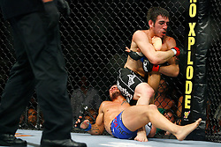 August 9, 2008; Minneapolis, MN, USA;  LIghtweights Kenny Florian (black trunks) and Roger Huerta (blue/white trunks) battle during their bout at the Target Center in Minneapolis, MN at UFC 87: Seek and Destroy.  Florian won a 3 round unanimous decision.