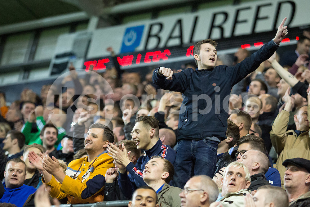 Sheffield Wednesday Fans celebrate their win over local rivals Rotherham United during the Sky Bet Championship match between Rotherham United and Sheffield Wednesday at the Aesseal New York Stadium, Rotherham, England on 23 October 2015. Photo by James Williamson.
