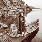 Vintage Photo: Indian Girl in a canoe,  circa 1900.