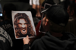November 11, 2011; Santa Monica, CA; USA; A young UFC fan looks at a picture of Clay Guida during the weigh-ins for the UFC on FOX.