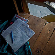 With no electricity light is not taken for granted. A child's homework laid out in the front door of their family's home. Image © Jonah Markowitz/Falcon Photo Agency