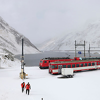 Train staff leaving the railway station at the top of the Oberalp Pass (2044m), connecting Uri with Graubüden, in the last days before the road to the pass closes for a seven month winter. The rail line remains open.