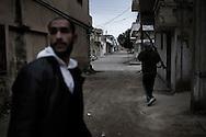 SYRIA - Al Qsair. A Syrian man is seen as a Free Syrian Army fighters is carring an RPG in Al Qsair, on February 24, 2012. ALESSIO ROMENZI