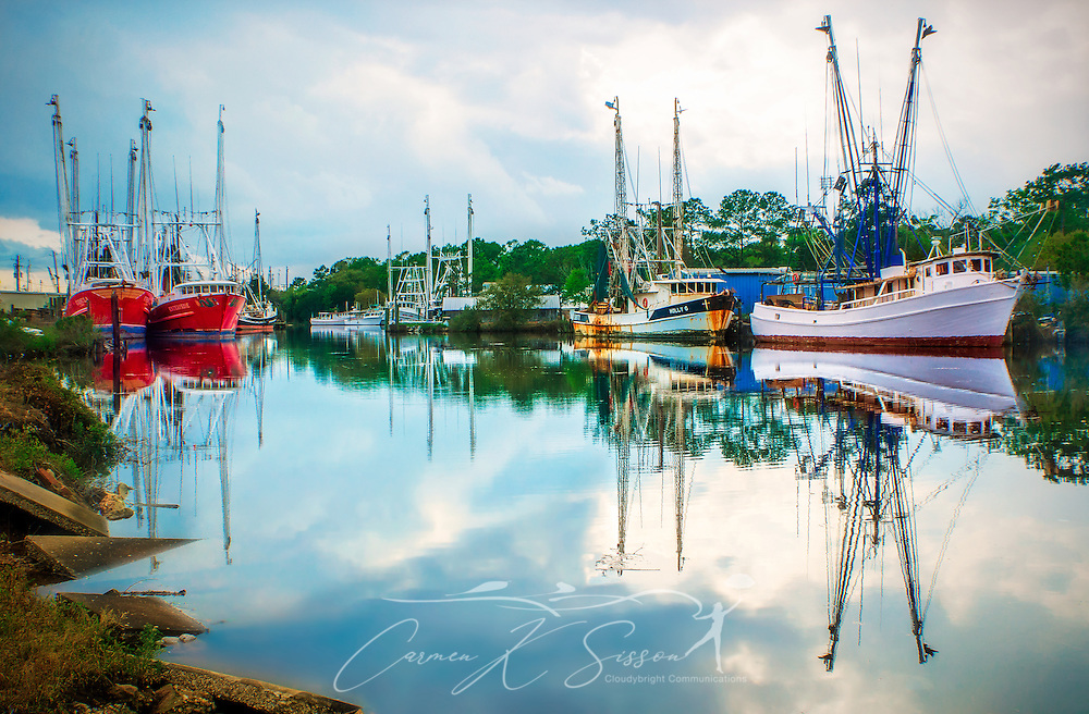"""Shrimp boats are docked in Bayou La Batre, Alabama, as a storm approaches April 8, 2014. The area is known as the """"Seafood Capital of Alabama."""" It was founded in 1786 and had a population of 2,558 at the 2010 Census. (Photo by Carmen K. Sisson/Cloudybright)"""