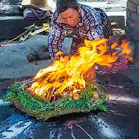 CHICHICASTENANGO , GUATEMALA - JULY 26 : Guatemalan man take part in a traditional Mayan ceremony in Chichicastenango , Guatemala on July 26 2015