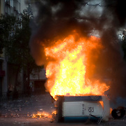 Fire billows out of a portable toilet on the main street of Syntagma (constitution) square in Athens, Greece. Image © Angelos Giotopoulos/Falcon Photo Agency