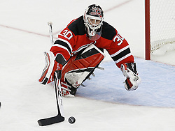 Mar 20, 2009; Newark, NJ, USA; New Jersey Devils goalie Martin Brodeur (30) makes a save during the third period at the Prudential Center.  The Devils defeated the Wild 4-0.
