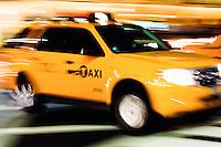 taxis in evening street scene in New York City October 2008