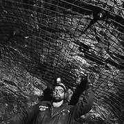 A rockbolter with a stoper on the 2500 level at the Strathcona (nickel and copper) Mine in Onaping (Sudbury), Ontario, Canada at the time owned by Falconbridge. This mine is a part of the Sudbury basin, one of the richest mining regions in the world. (Credit Image: © Louie Palu/ZUMA Press)
