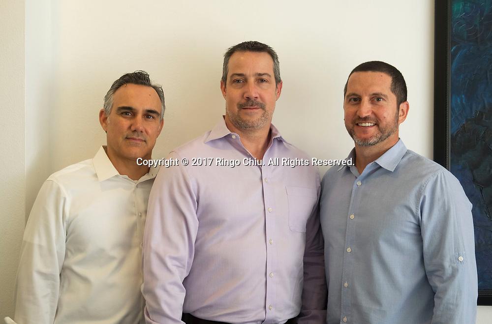 Ryan J. Clark, Michael Wildeveld and Robert Rodriguez, partners at the Veld Group.  (Photo by Ringo Chiu)