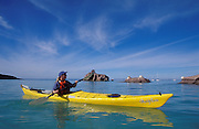 Baja California Sur, Mexico: woman sea kayaking in the Sea of Cortez at Espiritu Santo Island, near La Paz. .