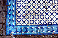 Blue tile embellishes the floor at a fish market in Essaouria, Morocco.