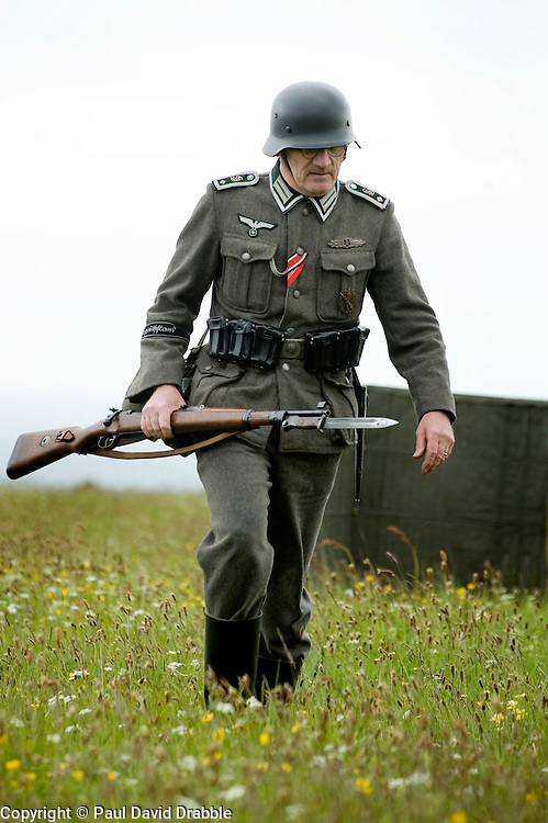 Member of the Northern World War Two Association portraying a soldier from 8th Company 2nd Battalion Grossdeutschland Division German Army with fixed bayonet and K98 rifle . Scarborough Castle Saturday 29th May 2010 .<br /> Image &copy; Paul David Drabble