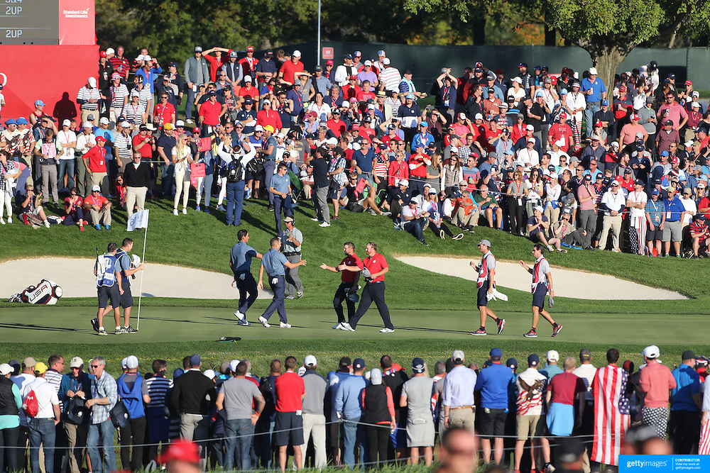 Ryder Cup 2016. Day One. Sergio Garcia and Rafa Cabrera Bello of Europe shake hands with J.B. Holmes and Ryan Moore of the United States after a European win on the sixteenth hole in the Friday afternoon four-ball competition during the Ryder Cup at  Hazeltine National Golf Club on September 30, 2016 in Chaska, Minnesota.  (Photo by Tim Clayton/Corbis via Getty Images)