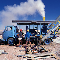 Australia, South Australia, Dust from dynamite blast billows from a blower at Stuart Bird's opal mine in Coober Pedy.