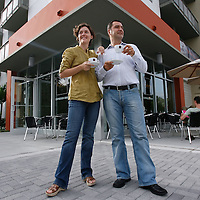 ST. PETERSBURG, FL -- July 01, 2008 -- Raphael and Sarah Perrier, who opened the Kahwa Coffee Roasting retail cafe and espresso bar in downtown St. Petersburg, Fla., stand for a portrait outside of their cafe on Tuesday, July 01, 2008.  St. Petersburg's downtown is thriving with new shops, restaurants, and bars that are feeding off a younger, energetic crowd that fills its walkable map pinpointed with rejuvenated historic hotels and condos.
