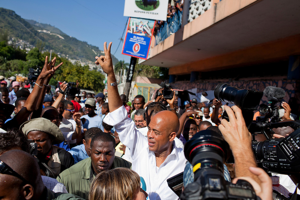 Haitian presidential candidate Michel Martelly (C) gestures to the crowd after casting his ballot on November 28, 2010 in Port-au-Prince, Haiti.