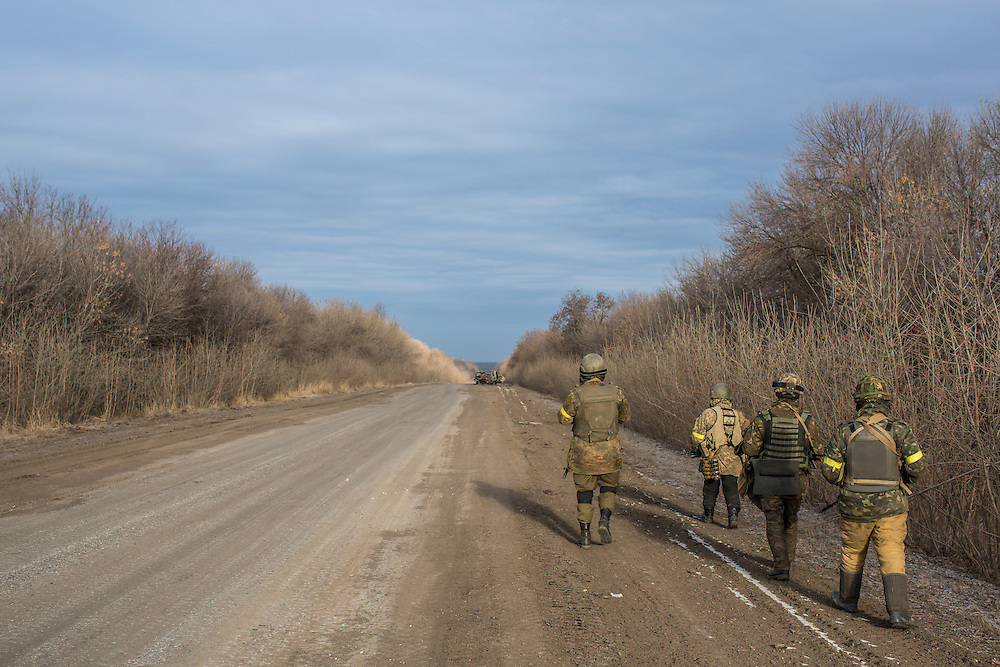 ARTEMIVSK, UKRAINE - FEBRUARY 19: Ukrainian soldiers walk the road leading out of Debaltseve on February 19, 2015 in Artemivsk, Ukraine. Ukrainian forces started withdrawing from the strategic and hard-fought town of Debaltseve yesterday being effectively surrounded by pro-Russian rebels. (Photo by Brendan Hoffman/Getty Images) *** Local Caption ***
