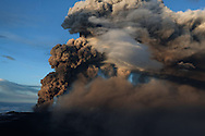 Shaping a lion head, ash and tephra ejected from Iceland's Eyjafjallajokull crater during it's eruption, spewing tephra and ashes that drift toward continental Europe. On this day the ash cloud rose to an average of 6 km (20,000 ft) peaking at 8 km (26,000 ft) said Icelandic Meteorological Office and Institute of Earth Sciences, University of Iceland.15 May 2010. © Etienne de Malglaive.