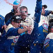 Crew members celebrate Marcos Ambrose's win in the NASCAR Nationwide Series Zippo 200 at Watkins Glen International Speedway.<br /> Watkins Glen, NY, August 2008.