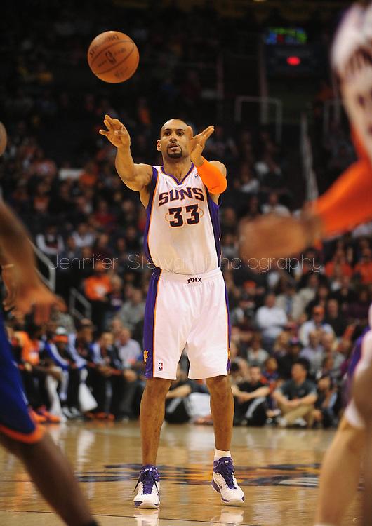 Jan. 7 2011; Phoenix, AZ, USA; Phoenix Suns forward Grant Hill (33) makes a pass against the New York Knicks at the US Airways Center. The Knicks defeated the Suns 121-96. Mandatory Credit: Jennifer Stewart-US PRESSWIRE.