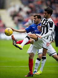 Cowdenbeath's Mohammed Yakud and Dunfermline's Faissal El Bahktaoui. Half time : Dunfermline 0 v 0 Cowdenbeath, Scottish League Cup game played today at East End Park.