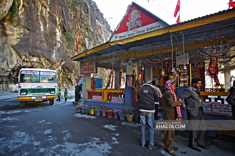 HRTC staff and Passengers stop at Taranda Mata Temple for blessings before crossing the Taranda Cliff to Kinnaur. .The 'Taranda Dhank' or Taranda Cliff took more then hundreds of lives of the people crossing it, so every vehical stops at the temple before moving ahead on the dangerous road to Kinnaur.