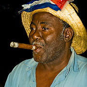 Smoking a Cuban cigar in Old Havana, Habana Vieja, Cuba.