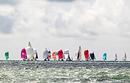 Yachts race downwind under spinnakers on the opening day of Aberdeen Asset Management Cowes Week. The event began in in 1826 and plays a key part in the British sporting summer 'season'. It now stages up to 40 daily races for around 1,000 boats and is the largest sailing regatta of its kind in the world with 8,500 sailors competing.<br /> Picture date Saturday 2nd August, 2014.<br /> Picture by Christopher Ison. Contact +447544 044177 chris@christopherison.com