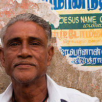 Portrait of a fisherman at Santhome. Santhome Beach and adjoining Marina Beach in Chennai, India were hit hard by the 2004 Tsunami. Fishermen and their families were the main victims living in their lightweight huts on the long and flat beaches of the area. All structures within 300 metres of the sea have now been banned and any left standing after the Tsunami were demolished. The fishermen and their families have now been relocated to government blocks of flats which has become a Santhome slum for fishermen and their families.