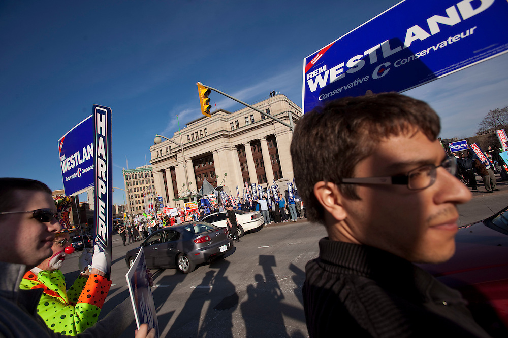 Supporters of all parties gather outside the Government Conference Centre in Ottawa, Ontario prior to the english language debate April 12, 2011.<br /> AFP/GEOFF ROBINS/STR