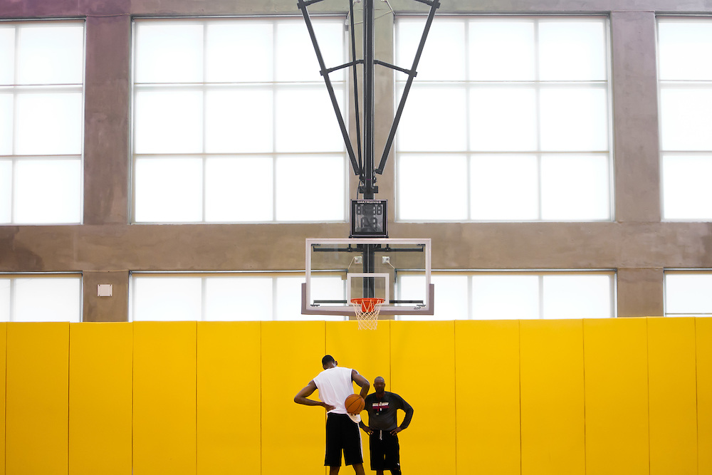 MIAMI, FL -- January 29, 2012 -- Miami center Mickell Gladness, left, shoots in the Heat's practice gym with assistant coach Keith Askins prior to their 97-93 win over the Chicago Bulls at American Airlines Arena in Miami, Fla., on Sunday, January 29, 2012.  (Chip Litherland for ESPN the Magazine)