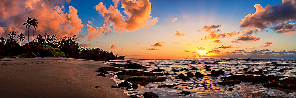 Photographic panorama artwork of a dramatic sunset over Oahu's north shore in Hawaii