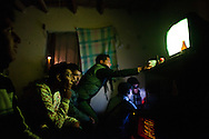 Teenagers watch television and drink beer at a friend's house in the Diaz Ordaz colonia.