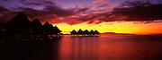 Sunrise image of overwater bungalows at the Intercontinental Le Moana Resort on Bora Bora, Tahiti, French Polynesia
