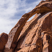 Jug Handle Arch, along Potash road / State Road 279, on BLM federal land near Moab, Utah, USA. The Bureau of Land Management (BLM) is an agency within the United States Department of the Interior that administers American public lands.