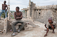 Boys play marbles on a rooftop on July 13, 2010 in the Fort National neighborhood in Port-au-Prince, Haiti.