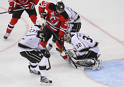 June 2; Newark, NJ, USA; Los Angeles Kings goalie Jonathan Quick (32) makes a save on New Jersey Devils center Ryan Carter (20) during the first period of the 2012 Stanley Cup Finals Game 2 at the Prudential Center.