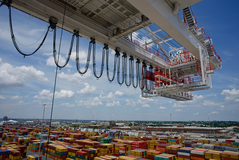 (photo by Matt Roth).Wednesday, July 11, 2012.Assignment ID: 30128574A..The trolly festoon of the first of Four super-post Panamax cranes to be erected looms over at The Port of Baltimore's Seagirt Marine Terminal's container yard Wednesday, July 11, 2012. ..Once the building, testing and training is finished, the Seagirt terminal will join Norfolk, VA as one of the only two ports on the East Coast which can unload new Panamax sized container ships. The cranes are expected to be fully operational in September of this year.