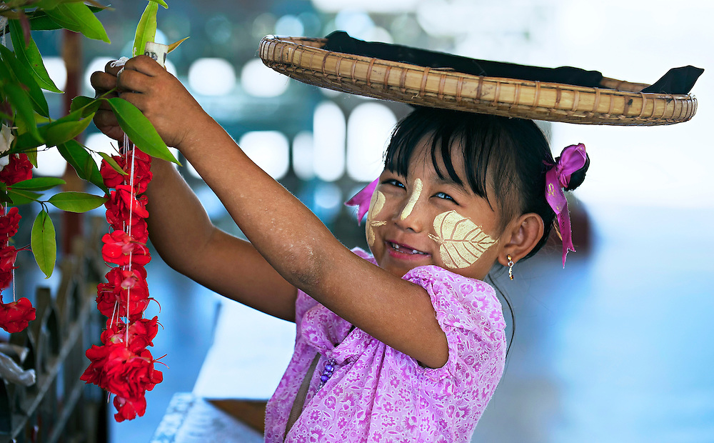 Children can be found at most temples in Myanmar selling trinkets.