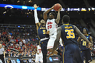 Ole Miss' Nick Williams (20) is fouled by La Salle's Taylor Dunn (5) in the Round of 32 of the NCAA Tournament at the Sprint Center in Kansas City, Mo. on Sunday, March 24, 2013.