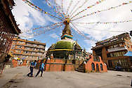 The beautiful squares of Kathmandu are swarming with activity.  This one, centered by a Tibetian Buddhist stupa,  is being used as a soccer pitch by some local boys.