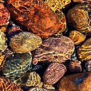 &quot;Underwater Treasure<br /> <br /> The underwater glimmer of beautiful weather worn stones of Lake Superior! Shimmering in the water from the bright sun shining above!!<br /> Brilliant colors of rust, orange, blue, yellow, gold, red, pink,and gray smooth stones sparkle like treasure in the shallow waters below!!<br /> <br /> Nature Abstracts by Rachel Cohen