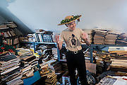 Tony Gennaro, 84, stands in his collection of magazines and books in his home in West Aliquippa. Gennaro, a weightlifter who held both national and world titles is also a former steelworker that worked in the blooming mill at the J&L facility in Aliquippa.